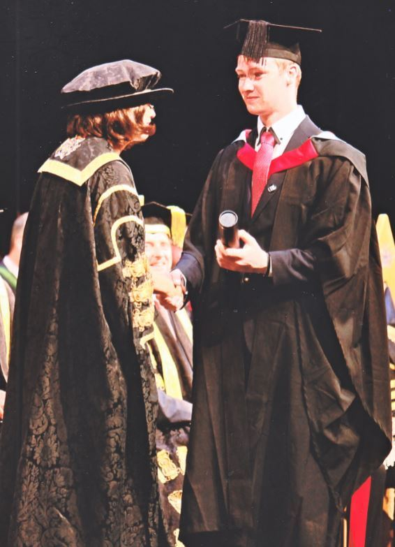 Graduation: Ryan Finlayson receives his certificate from University of Derby Vice-Chancellor Kathryn Mitchell