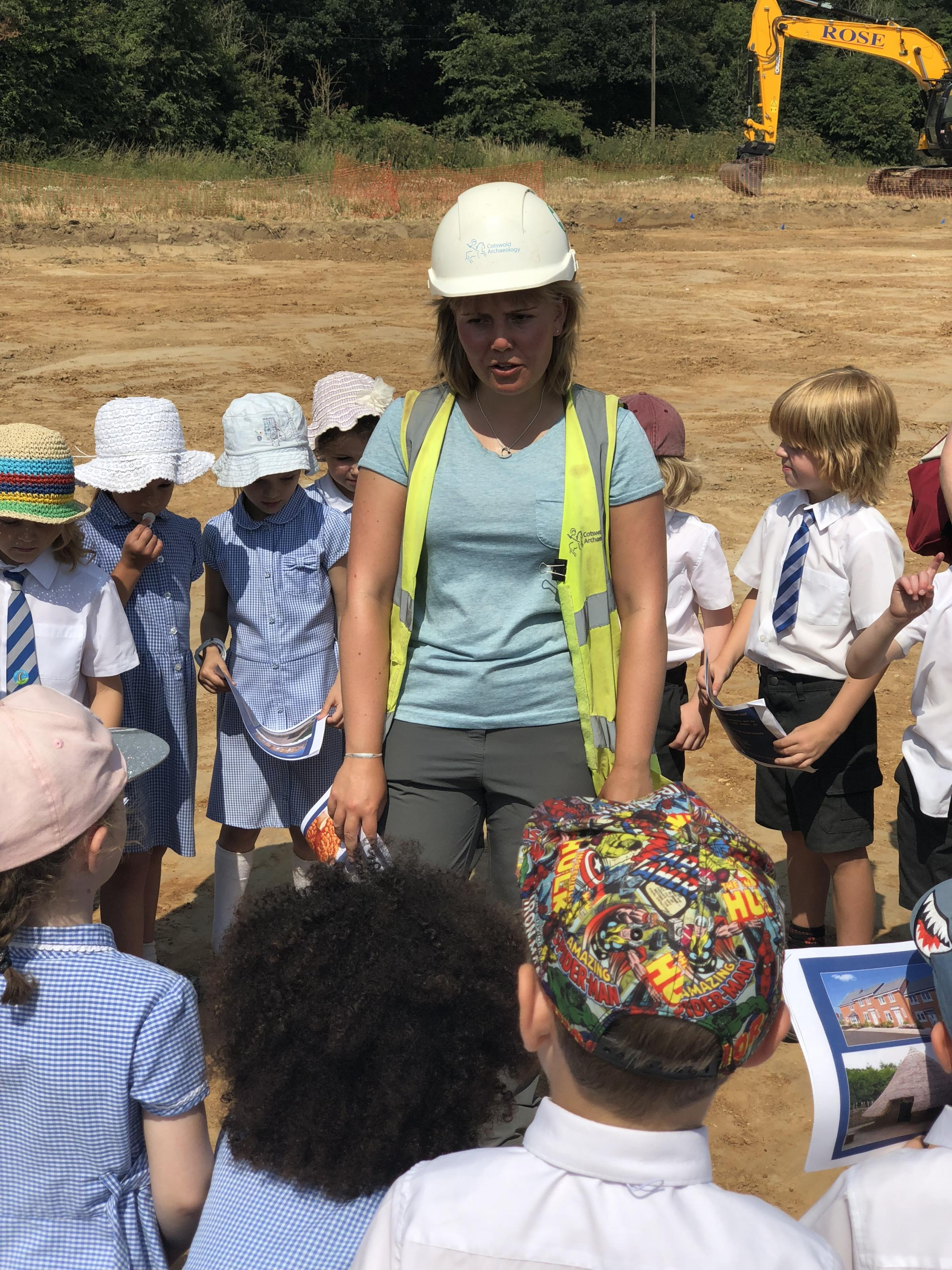 Project supervisor Anna Moosbauer from Cotswold Archaeology talking to children from Lawford Primary at the archaeological dig site