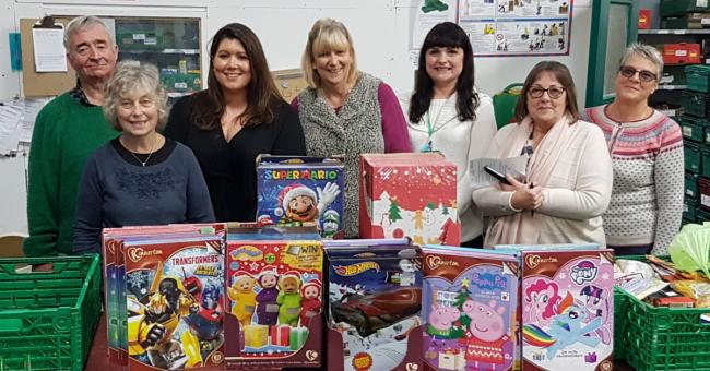 Employees donate 100 advent calendars to foodbank