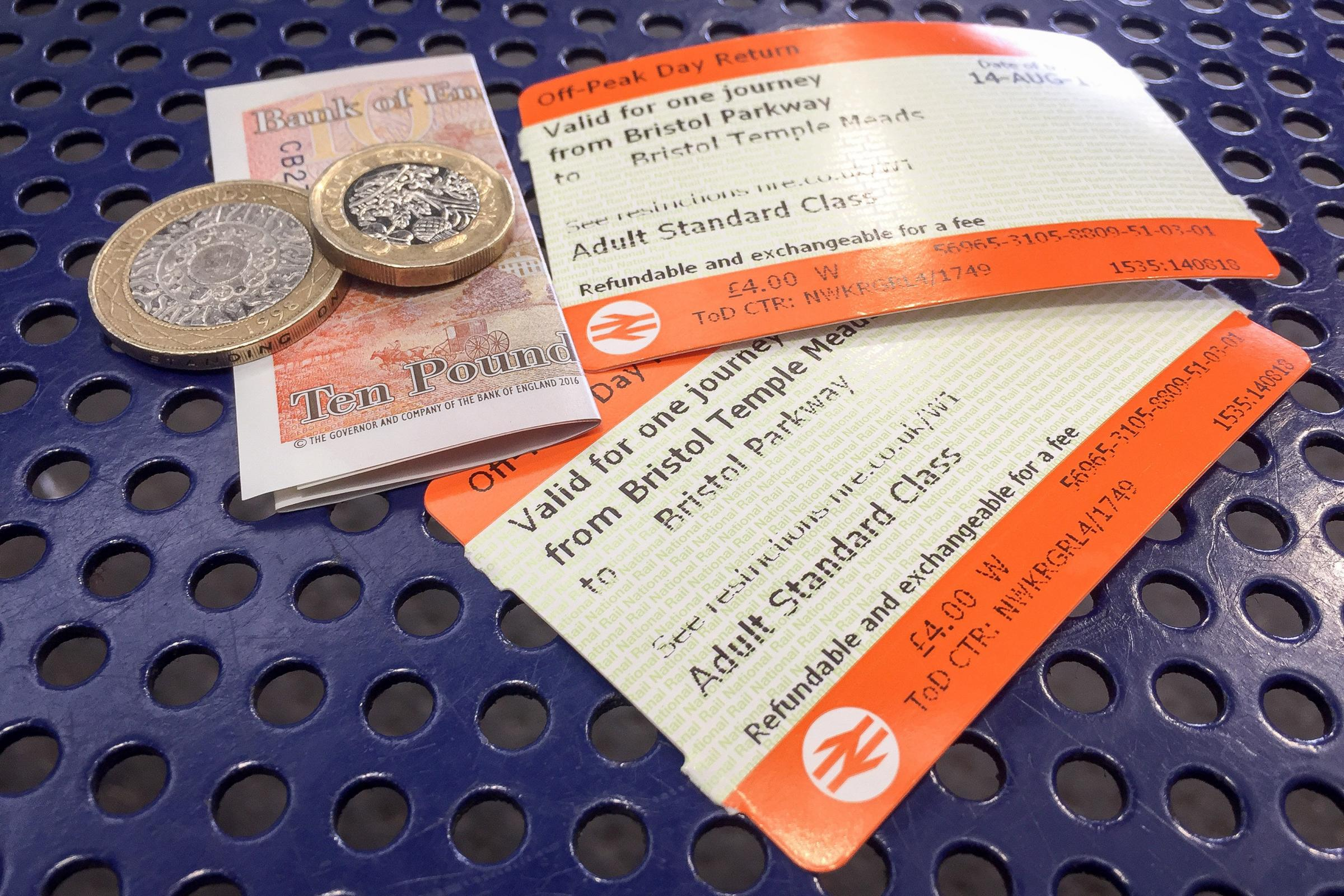 File photo dated 14/8/2018 of off-peak day return rail tickets and money. Britain's rail fares will increase by an average of 3.1% on January 2, industry body the Rail Delivery Group said. PRESS ASSOCIATION Photo. Issue date: Friday November 30, 201