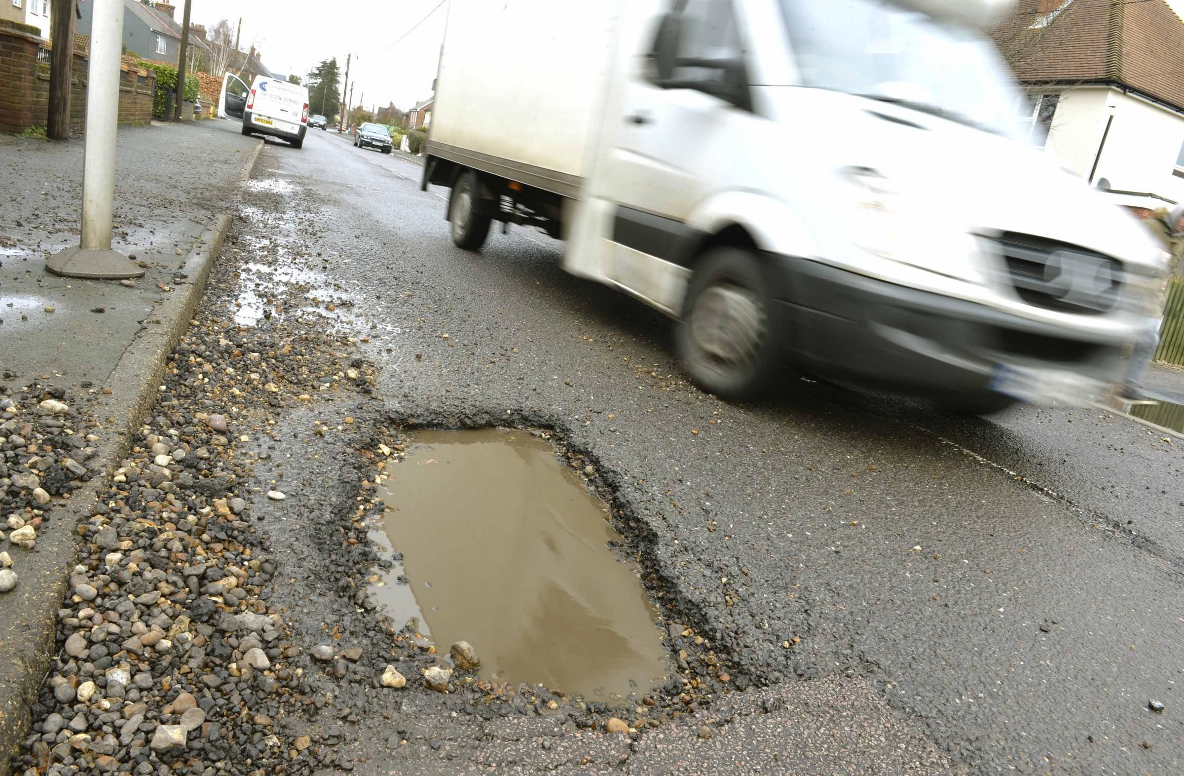Pot Holes and damaged road surface in Rectory Road, Wivenhoe