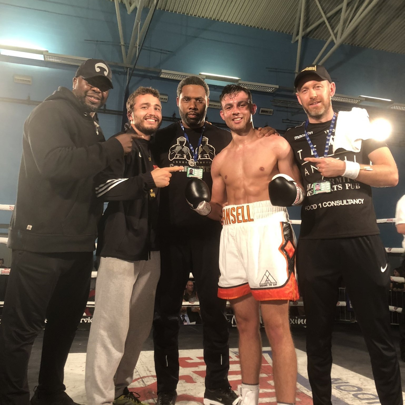 Tom Ansell with his training team after his fifth win as a professional boxer against Lee Hallett..