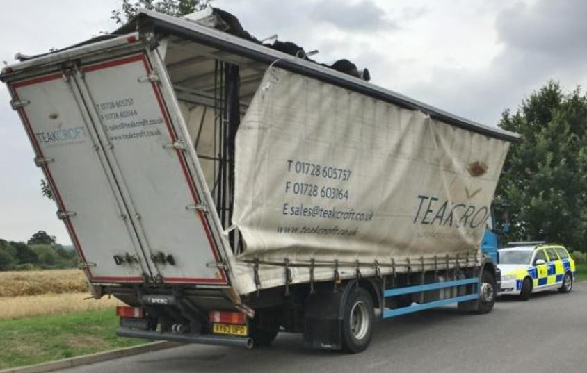Badly bent: The lorry which was driven into the bridge last August