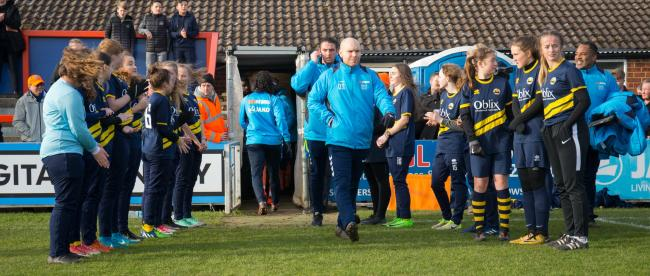 manager Danny Searle gets a guard of honour from Braintree Town Girls under-15s. Picture: Chris Jarvis