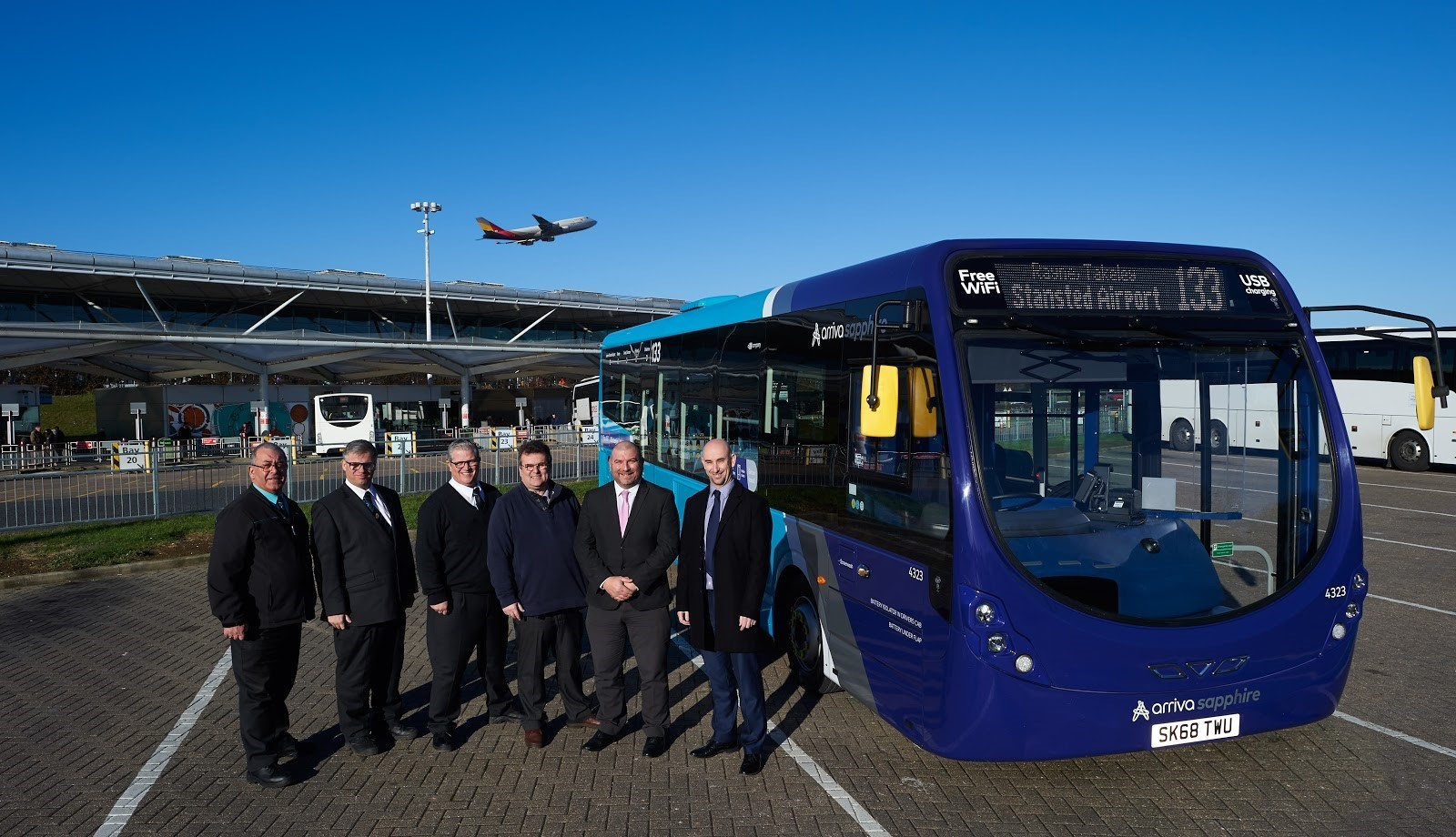 New route: Bosses beside one of the buses which will operate