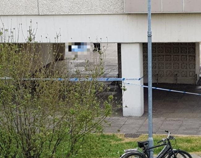 Police cordon in place after body found near tower blocks