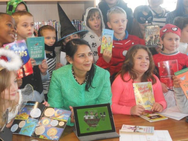 Get reading: Priti Patel launched this year's scheme at Powers Hall Academy, in Witham