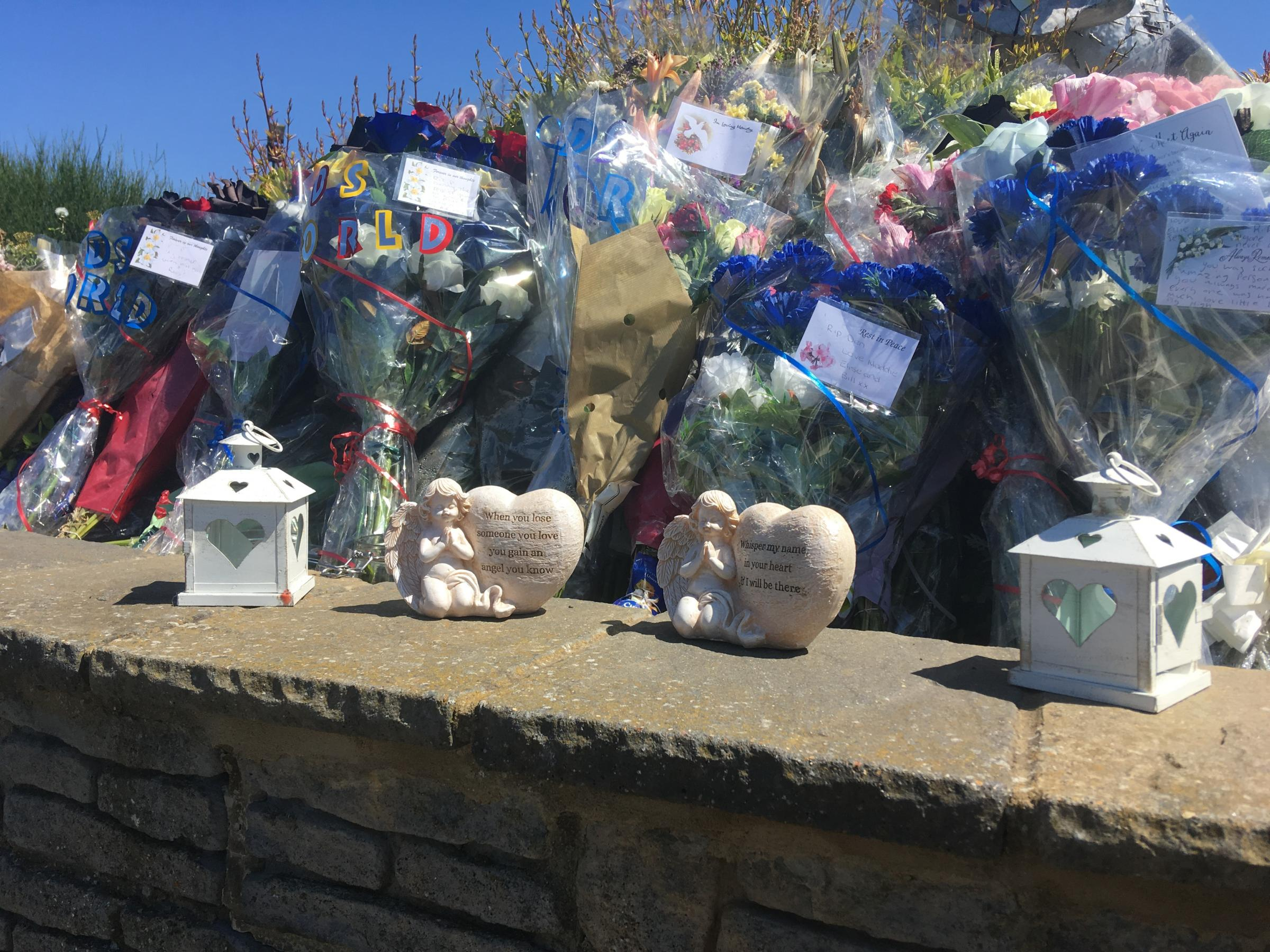 Tributes - Friends of Denny have left flowers, candles and messages in Canvey Central Park